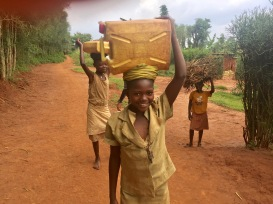 Local girls carrying water from village pump