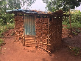 Outhouse - outdoor enclosed toilet in Musha, Rwanda